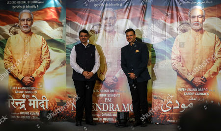 Devendra Fadnavis (L) chief minister of Maharashtra and bollywood actor Vivek Oberoi (R) pose for photographs during the poster launch of upcoming film 'PM Narendra Modi', a biopic on Indian Prime Minister, Narendra Modi, in Mumbai, India, 07 January 2019. Vivek Oberoi plays the character of Indian Prime Minister Narendra Modi in the movie.