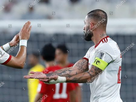 Iran's Ashkan Dejagah, right, celebrates with his teammate Iran's Ramin Rezaeian after scoring his side's second goal during the AFC Asian Cup group D soccer match between Iran and Yemen at the Mohammed Bin Zayed Stadium in Abu Dhabi, United Arab Emirates