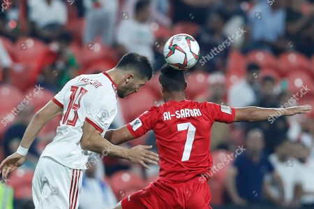 Stock Image of Iran's Majid Hosseini, left, and Yemen's Ahmed Al-Sarori challenge for the ball during the AFC Asian Cup group D soccer match between Iran and Yemen at the Mohammed Bin Zayed Stadium in Abu Dhabi, United Arab Emirates