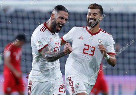 Iran's midfielder Ashkan Dejagah, left, celebrates with his teammate Iran's defender Ramin Rezaeian after scoring his side's second goal during the AFC Asian Cup group D soccer match between Iran and Yemen at the Mohammed Bin Zayed Stadium in Abu Dhabi, United Arab Emirates