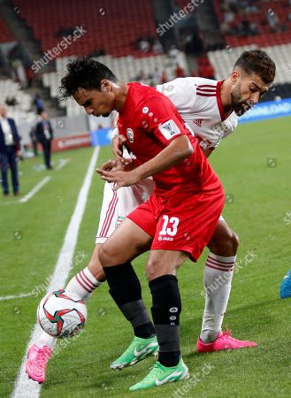 Ala Addin Mahdi (Front) of Yemen in action against Ramin Rezaeian of Islamic Republic of Iran during the 2019 AFC Asian Cup group D preliminary round match between Iran and Yemen in Abu Dhabi, United Arab Emirates, 07 January 2019.