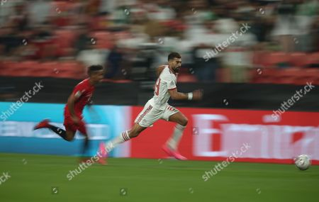 Ramin Rezaeian (R) of Iran in action during the 2019 AFC Asian Cup group D preliminary round match between Iran and Yemen in Abu Dhabi, United Arab Emirates, 07 January 2019.