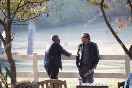 Reg E. Cathey as Chief Giles and Philip Glenister as Reverend Anderson