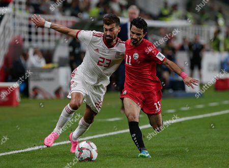 Iran's defender Ramin Rezaeian. left, and Yemen's forward Abdulwasea Al-Matari fight for the ball during the AFC Asian Cup group D soccer match between Iran and Yemen at the Mohammed Bin Zayed Stadium in Abu Dhabi, United Arab Emirates