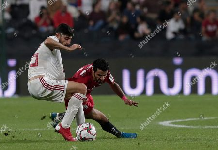 Iran's midfielder Mehdi Torabi, left, and Yemen's midfielder Wahid Al-khyat fight for the ball during the AFC Asian Cup group D soccer match between Iran and Yemen at the Mohammed Bin Zayed Stadium in Abu Dhabi, United Arab Emirates