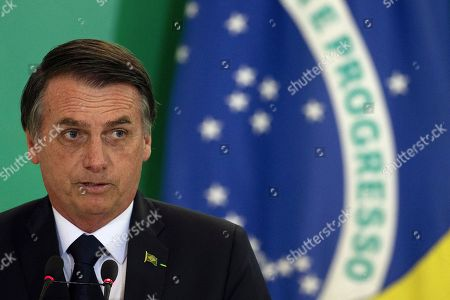 Brazilian President Jair Bolsonaro speaks during the possession ceremony of the presidents of the country's three main public banks, in Brasilia, Brazil, 07 January 2019. At the ceremony were presented the presidents of the Federal Economic Caixa, Pedro Guimaraes; Banco do Brasil, Rubem Novaes; and the National Bank for Economic and Social Development (BNDES), Joaquim Levy, all aligned with the liberal ideology of Economy Minister Paulo Guedes, an economist trained at the Chicago School.