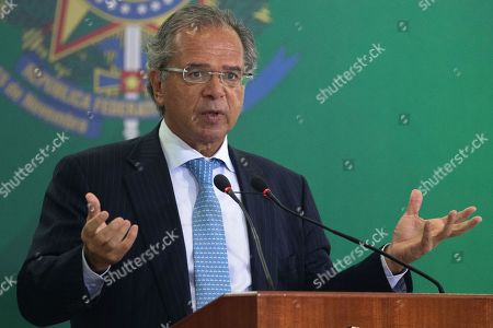 Stock Photo of Brazilian Economy Minister Paulo Guedes speaks during the possession ceremony of the presidents of the country's three main public banks, in Brasilia, Brazil, 07 January 2019. At the ceremony were presented the presidents of the Federal Economic Caixa, Pedro Guimaraes; Banco do Brasil, Rubem Novaes; and the National Bank for Economic and Social Development (BNDES), Joaquim Levy, all aligned with the liberal ideology of Economy Minister Paulo Guedes, an economist trained at the Chicago School.