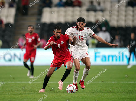 Ala Al-Sasi of Yemendribbling past Mehdi Torabi of Iran during Iran v Yemen at the Al-Nahyan Stadium in Abu Dhabi, UAE, AFC Asian Cup, Asian Football championship