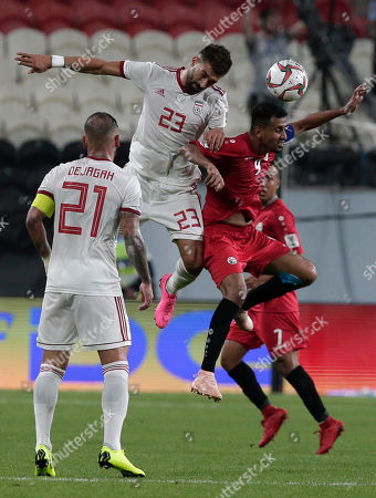 Yemen's midfielder Ala Al Sasi, right, heads the ball past Iran's defender Ramin Rezaeian during the AFC Asian Cup group D soccer match between Iran and Yemen at the Mohammed Bin Zayed Stadium in Abu Dhabi, United Arab Emirates