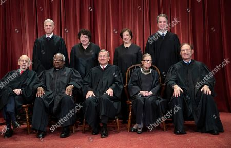 Stephen Breyer, Clarence Thomas, John G. Roberts, Ruth Bader Ginsburg, Samuel Alito Jr., Neil Gorsuch, Sonia Sotomayor, Elena Kagan, Brett M. Kavanaugh. From, the justices of the U.S. Supreme Court gather for a formal group portrait to include new Associate Justice, top row, far right, at the Supreme Court Building in Washington, Friday, Nov. 30, 2018. Justice Ginsburg, 85, is missing arguments for the first time in more than 25 years as she recuperates from cancer surgery last month but is recuperating and working from home. Seated from left: Associate Justice Stephen Breyer, Associate Justice Clarence Thomas, Chief Justice of the United States John G. Roberts, Associate Justice Ruth Bader Ginsburg and Associate Justice Samuel Alito Jr. Standing behind from left: Associate Justice Neil Gorsuch, Associate Justice Sonia Sotomayor, Associate Justice Elena Kagan and Associate Justice Brett M. Kavanaugh