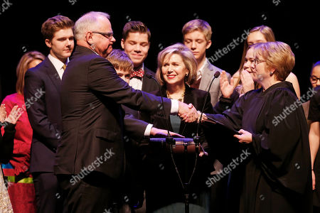 Tim Walz, Lorie Skjerven Gildea. Minnesota Governor Tim Walz, left, shakes hands with Minnesota Supreme Court Chief Justice Lorie Skjerven Gildea, right, after she swore him in during his inaugural, in St. Paul, Minn. In center, holding the Bible is Walz' wife Gwen