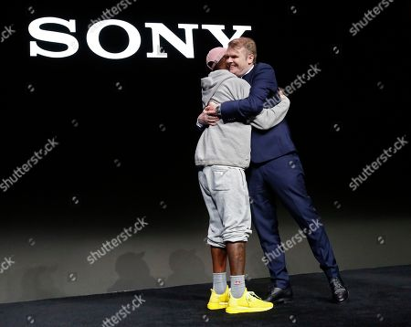 Stock Photo of Chief Executive Officer Sony Music Entertainment Rob Stringer (R) hugs US rapper Pharrell Williams (R) during the 2019 International Consumer Electronics Show in Las Vegas, Nevada, USA, 07 January 2019. he annual CES, which takes place from 08 to 11 January, is a place where industry manufacturers, advertisers and tech-minded consumers converge to get a taste of new innovations coming to the market each year