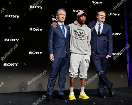 Stock Image of Kenichiro Yoshida, President and CEO of Sony Corp. (L), Chief Executive Officer of Sony Music Entertainment Rob Stringer (R) and US rapper Pharrell Williams (C) embrace during the 2019 International Consumer Electronics Show in Las Vegas, Nevada, USA, 07 January 2019. he annual CES, which takes place from 08 to 11 January, is a place where industry manufacturers, advertisers and tech-minded consumers converge to get a taste of new innovations coming to the market each year