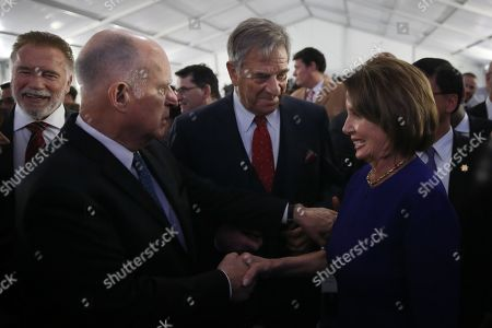 Outgoing California Governor Jerry Brown (L) shakes hands with U.S. Speaker of the House Nancy Pelosi (R) following California Governor-elect Gavin Newsom's inauguration ceremony at the State Capitol in Sacramento, California, USA, 07 January 2019. Others are not identified.
