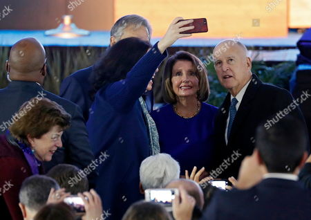 US States Speaker of the House Nancy Pelosi (L) and former Governor of California Jerry Brown (R) pose for a selfie before California Governor-elect Gavin Newsom is sworn in at the State Capitol in Sacramento, California, USA, 07 January 2019. The Democrat Gavin Newsom has been officially sworn in as the 40th Governor of California.