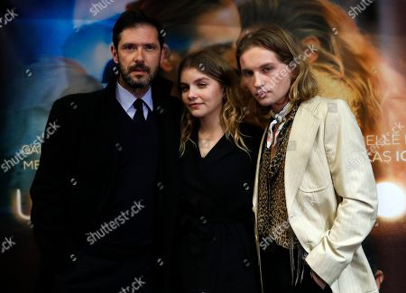 "Actress Galatea Bellugi, center, actor Lukas Ionesco, right, and Melvil Poupaud pose during the premiere of the movie ""Une Jeunesse Doree"" in Paris"