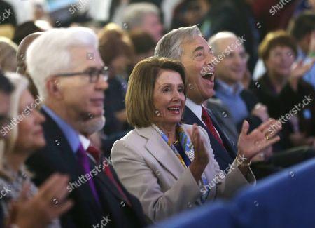 Stock Image of Nancy Pelosi, Paul Pelosi. Speaker of the House Nancy Pelosi claps and her husband Paul Pelosi, right, laughs during the inauguration of California Gov. Gavin Newsom, in Sacramento, Calif. At left is former California Gov. Gray Davis