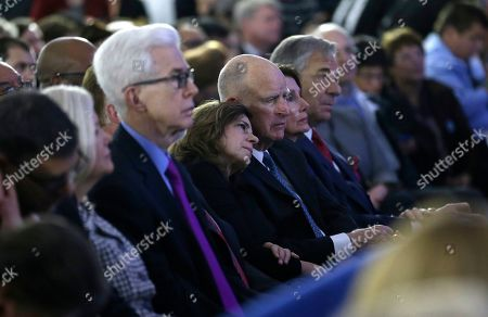 From left, former California first lady Sharon Davis, former governor Gray Davis, first lady Anne Gust Brown, Governor Jerry Brown, Speaker of the House Nancy Pelosi and her husband Paul Pelosi watch the inauguration of California Governor Gavin Newsom, in Sacramento, Calif