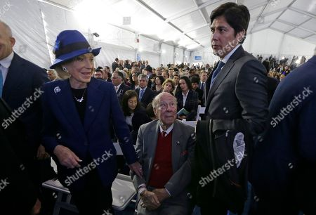 George Shultz, Charlotte Mailliard Shultz, Kevin DeLeon. Former Secretary of State George Shultz, center, sits between his wife, Charlotte Mailliard Shultz, left, and Kevin DeLeon, right, former state Senate leader, before the inauguration of California Governor Gavin Newsom, in Sacramento, Calif