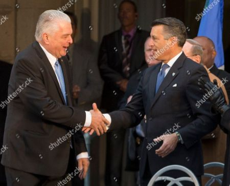 Stock Image of Governor-elect Steve Sisolak is congratulated by Governor Brian Sandoval during his inauguration on the steps of the Nevada State Capitol in Carson City, Nev