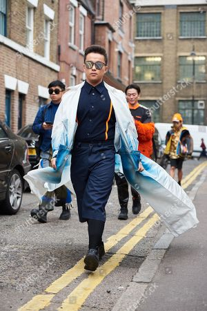 Stock Picture of Tianwei Zhang wearing a Fengchen Wang trench coat