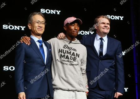 Sony President and CEO Kenichiro Yoshida, left, musician Pharrell Williams, middle, and Sony Music Entertainment CEO Rob Stringer, right, pose for a photograph at the Sony news conference at CES International, in Las Vegas