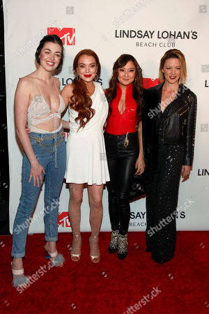 "Barrett Wilbert Weed, Lindsay Lohan, Ashley Park, Kate Rockwell. Barrett Wilbert Weed, from left, Lindsay Lohan, Ashley Park and Kate Rockwell attend MTV's ""Lindsay Lohan's Beach Club"" series premiere party at Magic Hour Rooftop at The Moxy Times Square, in New York"