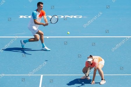 Bernard Tomic (L) and Sara Tomic (R) of Australia play mixed doubles against John Peers and Sally Peers of Australia during match four of Kooyong Classic tennis tournament at Kooyong Lawn Tennis Club in Melbourne, Australia, 08 January 2019.