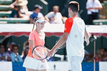Bernard Tomic (R) and Sara Tomic (L) of Australia play mixed doubles against John Peers and Sally Peers of Australia during match four of Kooyong Classic tennis tournament at Kooyong Lawn Tennis Club in Melbourne, Australia, 08 January 2019.