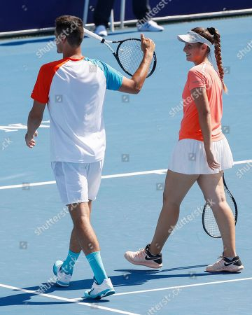 Bernard Tomic (L) and Sara Tomic of Australia play mixed doubles against John Peers and Sally Peers of Australia during match four of Kooyong Classic tennis tournament at Kooyong Lawn Tennis Club in Melbourne, Australia, 08 January 2019.