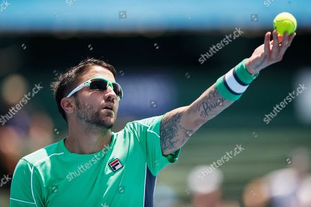 Janko Tipsarevic of Serbia serves against Jason Kubler of Australia during match two of the Kooyong Classic at Kooyong Lawn Tennis Club in Melbourne, Australia, 08 January 2019.