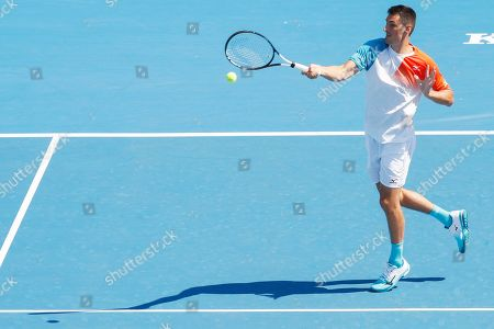 Bernard Tomic and Sara Tomic (not pictured) of Australia play mixed doubles against John Peers and Sally Peers of Australia during match four of Kooyong Classic tennis tournament at Kooyong Lawn Tennis Club in Melbourne, Australia, 08 January 2019.