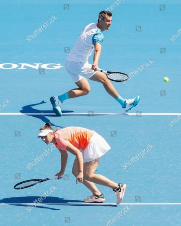 Bernard Tomic (top) and Sara Tomic (bottom) of Australia play mixed doubles against John Peers and Sally Peers of Australia during match four of Kooyong Classic tennis tournament at Kooyong Lawn Tennis Club in Melbourne, Australia, 08 January 2019.