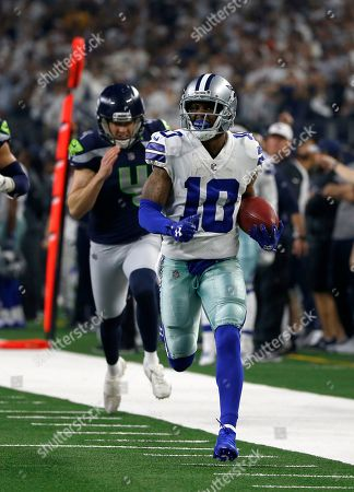 2d2b2900f Seattle Seahawks punter Michael Dickson (4) gives chase as Dallas Cowboys  wide receiver Tavon ...