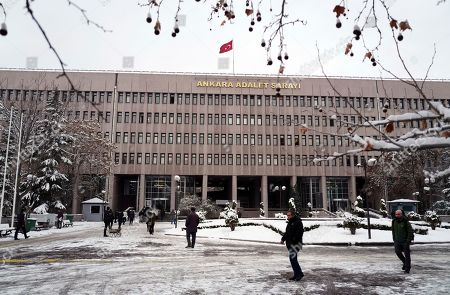 Stock Photo of People walk outside the main courthouse in Ankara, Turkey, . The trial has opened against 28 people accused of involvement in the 2016 killing of Russia's ambassador to Turkey, including U.S.-based Muslim cleric Fethullah Gulen whom Turkey blames for a failed coup the same year. An off-duty police officer fatally shot Andrei Karlov at a photo exhibition in Ankara on Dec. 19, 2016