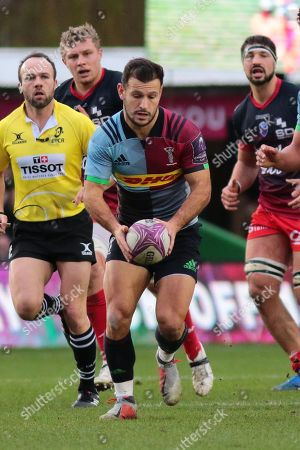 Danny Care of Harlequins sets up for a kick through
