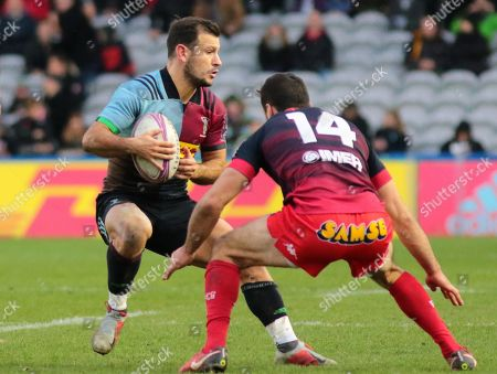 Lucas Dupont of Grenoble sets up to tackle Danny Care of Harlequins