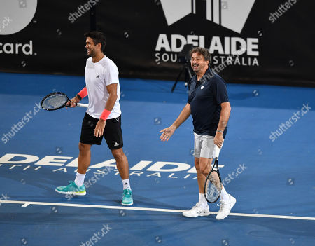 Henri Leconte (R) and Fernando Verdasco during their doubles match against Pat Cash and Daniel Munoz on day two at the World Tennis Challenge at Memorial Drive Park in Adelaide, Australia, 08 January 2019.