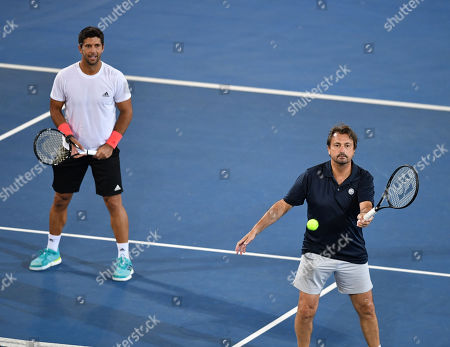 Henri Leconte (R) and Fernando Verdasco in action during their doubles match against Pat Cash and Daniel Munoz on day two at the World Tennis Challenge at Memorial Drive Park in Adelaide, Australia, 08 January 2019.