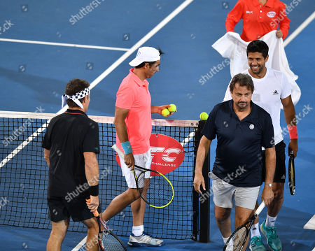 Pat Cash (L), Daniel Munoz (2-L), Henri Leconte (2-R) and Fernando Verdasco (R) during their doubles match on day two at the World Tennis Challenge at Memorial Drive Park in Adelaide, Australia, 08 January 2019.