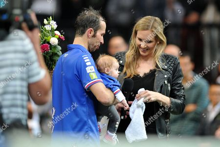 Stock Picture of Radek Stepanek officially ends his professional playing career at the O2 arena in Prague in the Czech Republic. Radek Stepanek with his daughter Stella next to his wife Nicole Vaidisova.