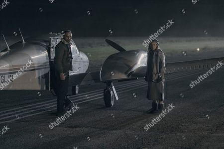 Stock Image of Greg Bryk as Ray Cushing and Elisabeth Moss as Offred