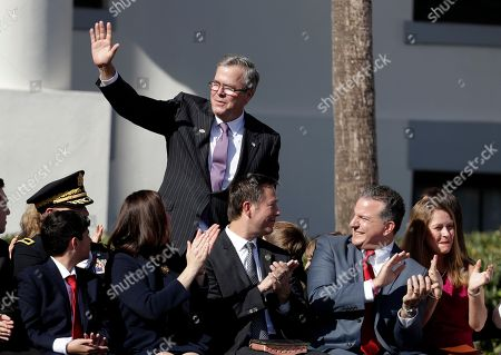 Former Florida Gov. Jeb Bush waves as he arrives for an inauguration ceremony, in Tallahassee, Fla. Republicans will begin their third decade dominating the state's Capitol