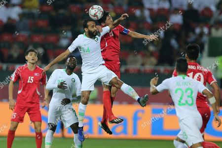 Saudi Arabia's midfielder Abdullah Otayf, top left, goes for a header with North Korea's midfielder Jong Il-Gwan, top right, during the AFC Asian Cup group E soccer match between Saudi Arabia and North Korea at the Rashid Stadium in Dubai, United Arab Emirates