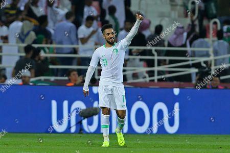 Saudi Arabia's midfielder Hattan Bahebri celebrates after scoring the opening goal during the AFC Asian Cup group E soccer match between Saudi Arabia and North Korea at the Rashid Stadium in Dubai, United Arab Emirates