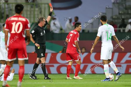 Australian referee Peter Green (L) shows the yellow card to Han Kwang Song (2-R) of North Korea during the 2019 AFC Asian Cup group E preliminary round match between Saudi Arabia and North Korea, in Dubai, United Arab Emirates, 08 January 2019.