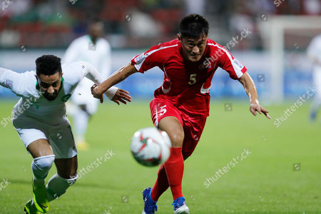 Saudi Arabia's midfielder Hattan Bahebri, left, fights for the ball with North Korea's defender An Song-Il during the AFC Asian Cup group E soccer match between Saudi Arabia and North Korea at the Rashid Stadium in Dubai, United Arab Emirates