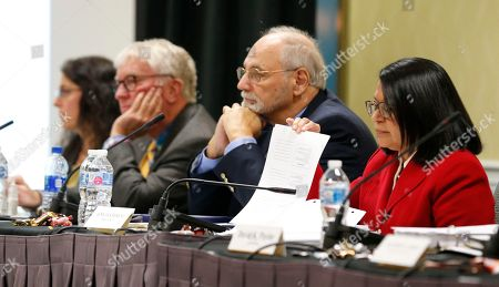 Richard Langford, Ignacia Moreno, William Ferguson, Nicole Rovner. Members of the Virginia State Air Quality Control Board, Chairman Richard Langford, second from right, Ignacia Moreno, right, William Ferguson, second from left, and Nicole Rovner, listen to a presentation during a board meeting in Richmond, Va., . The board is set to vote on a plan to build an Atlantic Coast Pipeline Compressor station in the state