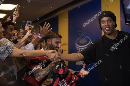 Brazil's former soccer player Ronaldinho Gaucho greets fans before printing his feet on a plaque that will be placed on Brazil's Soccer Walk of Fame at Maracana stadium in Rio de Janeiro, Brazil, . Ronaldinho was twice named FIFA World Player of the Year