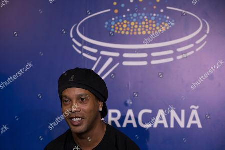 Brazil's former soccer player Ronaldinho Gaucho waits to print his feet on a plaque that will be placed on Brazil's Soccer Walk of Fame at Maracana stadium in Rio de Janeiro, Brazil, . Ronaldinho was twice named FIFA World Player of the Year